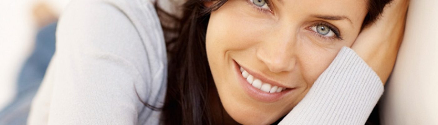 banner of dark-haired woman laying down and smiling