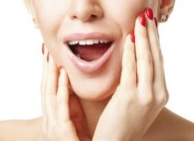 woman with red fingernails gasping happily