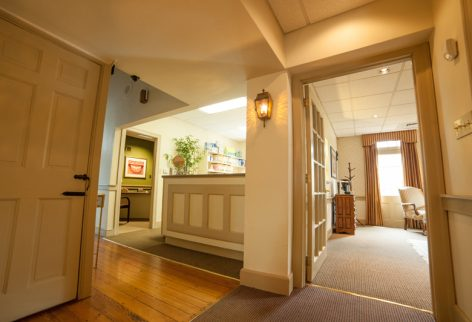picture of our dental office showing the front desk area and the entrance to the waiting room